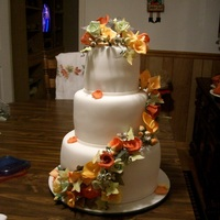 Fall Themed Wedding Cake Fondant covered cake covered in gum paste roses, hydrangeas, calla lilies, ivy leaves and rose buds. *Update - I got 1st place!