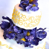 Iris Wedding Cake yellow and purple were the wedding colors so we went with yellow piping and purple sugar iris's.