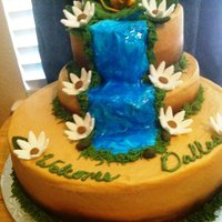 Baby Simba Babyshower Cake  This was my first paid cake by a non-relative. Their theme was baby simba. The cake was white with fresh strawberries and buttercream. The...