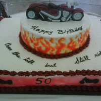 Birthday Cake I made this for my father-in-law when he turned 50. He like's motorcycles. This was my first cake this big and with so much detail. It...