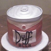 Duff Beer Cake   Modeled after a can of Homer Simpson's favorite beer. All cake and fondant.