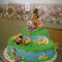 Fairy Baby Shower Cake Buttercream, with fondant flowers, and butterflies. Dog and doll are plastic