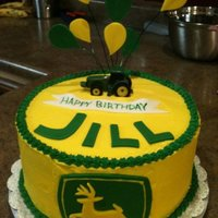 John Deere   A John Deere cake for a friend of mine. Covered in buttercream, the deere, letters, balloons, and banner were all fondant.