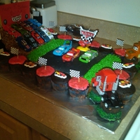 "Lightning Mcqueen Cars Cake  I made this cake for my son's 3rd bday! Chocolate cupcakes, yellow cake, and cocoa rice krispies for the ""bleachers"" Took me..."