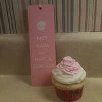 Good Advice A vanilla cupcake with caramel filling topped with vanilla buttercream alongside my favorite bookmark!