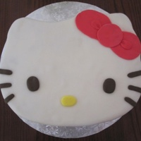 Hello Kitty Cake. I baked a quarter sheet cake, carved the face out, filled and masked with buttercream, and covered in homemade fondant. (I messed up on the...