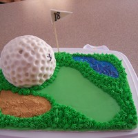Tee Time The only cake is the ball covered in rolled fondant. The rest of the decorations sit on top of a piece of cardboard. Perfect for a party of...