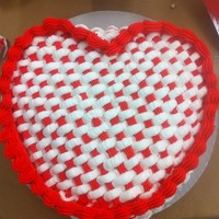 Heart-Shaped Basketweave Heart-shaped cake covered in red and white buttercream basketweave