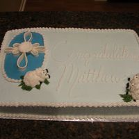 Lambs And Cross Was done for a baptism. All buttercream except the cross which is fondant. Thanks for looking!