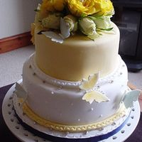 Butterfy Wedding Cake Two tier sponge cake decorated with fresh roses and sugar paste butterflies