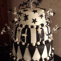 Black & White For Tom Harlequin style cake for Tom's 18th birthday, with hand made starbursts