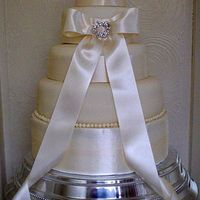 Elegance Three tier wedding cake with Ivory ribbon and jewelled brooch