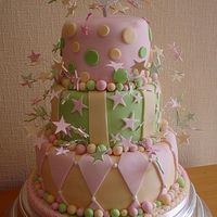 Harlequin Wedding Cake Three tier wedding cake in pastel colours and the harlequin design with hand made starbursts