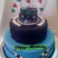 Monster Truck Cake For my son's 3rd birthday. Didn't have enough time to make an edible Grave Digger truck but he still LOVED his cake!