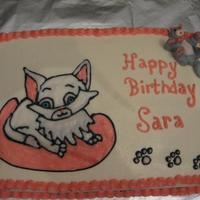 Birthday Cat this is for my sister in law birthday all buttercream , but cake topper is made from mmf. still getting use to working with it.