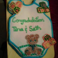 Baby Shower Cake here is a cake I did for a baby shower, I carved out the onesie and the bear and blocks are made from chocolate. I realize the blocks...