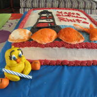 Light House its two cakes i made for my sister in law birthday and her mom's birthday. and my first gumpaste tweety bird