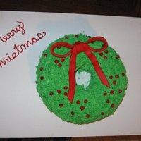 Christmas Wreath Christmas weath cake I made. The berries are Red Hots. The bow is fondant.