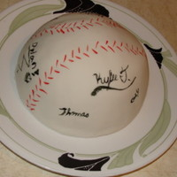 Signed Baseball  fondant covered, the guest all signed the cake with black edible marking pen, as they came into the party, big hit! This cake was in...