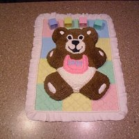 Teddy Bear I made my own baby shower cake, the blanket is made out of fondant..