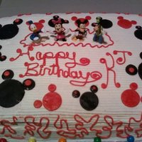 Mickey Mouse Birthday Cake buttercream icing w/fondant mickey heads and plastic figurines