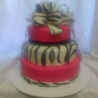 Pink Zebra chocolate bottom with strawberry filling and strawberry fondant, vanilla cake for middle,