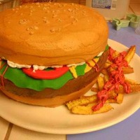 Hamburger Cake   This cake was made for a friend, three layers of cake the accents are fondant the fries are cake also.