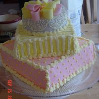 Baby Gift Cake Sorry about the background mess! This cake was frustrating but everyone seemed to love it. Thanks for looking!