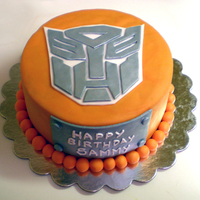 This Cake Is More Than Meets The Eye! My fourth fondant cake. I made this Transformers cake for my friend's son's 6th birthday. He loves orange.