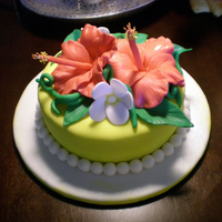 Tropical 30Th Anniversary Cake This is my third fondant cake and my first time working with gumpaste flowers. I think the Hibiscus flowers turned out pretty great! Happy...