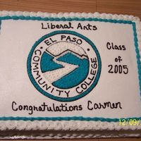 Graduation Cake Graduation Cake. School logo drawn on and then filled in witha star tip.