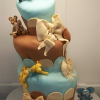 Animal Themed Baby Shower Cake This was my interpretation of a topsy turvy for a nursery animal themed shower cake for my good friend daughter! they loved the cake and...