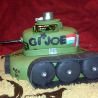 Gi Joe Birthday Cake Tank GI Joe cake Made out of chocolate cake and filled with cocholate chip buttercream covered in fondant and gumpaste details. Thanks for...