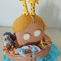 Noah's Ark Baby Shower Cake Fondant covered cake with all handmade gumpaste animal toppers made for a friends baby shower.