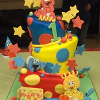 Sesame Street Babies 1St Birthday Topsy Turvy I MADE THIS CAKE LAST YEAR FOR MY FRIEND'S SON'S FIRST BIRTHDAY. THIS CAKE WAS INSPIRED BY A CAKE FROM CAKE LAVA IN HAWAII. IT...
