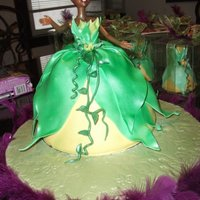 Princess Tiana Doll Cake This doll cake is Dominican cake filled with Guava filling and decorated with fondant and gumpaste details. Thank you for looking!