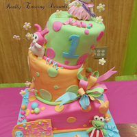 Hello Kitty & Friends Topsy Turvy Cake This cake was soooo awesome to make! wow the little girls party was so bright and colorful! great color scheme with this order! i loved it...