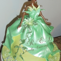 Princess Tiana Dress Cake This cake was for my friend's little girl! sooo cute i love these princess cakes! I made boxed cupcakes and mini Tiana Dress cakes all...