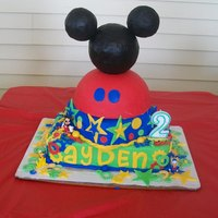 Mickey Mouse Clubhouse everything is made of cake and MMF except for the mickey mouse head, it is styrofoam balls wrapped in black MMF