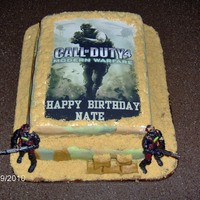 Call Of Duty First cake ever! My son wanted a Call of Duty cake for this bday. MMF for the camo look on cake. Chocolate cake w/Chocolate BC frosting....