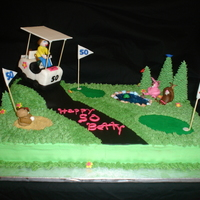 Betty's 50 Made for a lady that teaches golf and turning 50. Chocolate cake with Ganache filling, buttercream frosting,golf cart made with RKT and...
