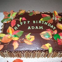 Autumn Theme 60Th Birthday Chocolate cake with chocolate ganache with coloured white chocolate leaves done on back of a real leaf