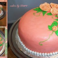 Birthday Roses' Cake A double layer marble cake with buttercream filling and frosting, royal icing roses and marshmallow fondant pearls border.