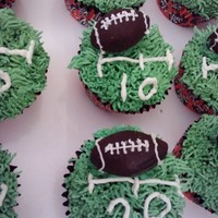 Football Cupcakes chocolate cupcakes with ganache filling, buttercream icing and the footballs are made of chocolate as well
