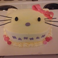 Hello Kitty Cake With Ribbon Roses chocolate cake and vanilla buttercream and fondant accents