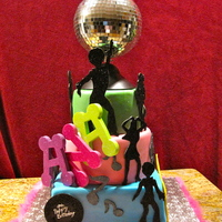 "Disco Cake  I made this cake for a little girl as a request for her 9th birthday. The disco ball spins on top of the 8"" tier. I didn't want..."