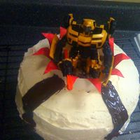 Transformer - Bumblebee Transformers - Bumblebee birthday cake. This is a chocolate vegan double layer cake made with buttercream icing. I cut a hole in the middle...