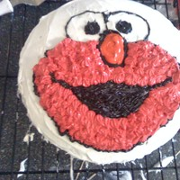 Elmo This is my first attempt at an Elmo birthday cake. I used white, store-bought icing and dyed it. I printed an Elmo face online and layed it...