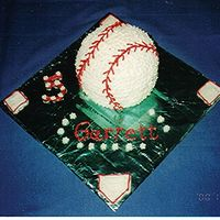 Baseball Cake   Made with the classic ball cake. Who'd a thought it! It was fun.