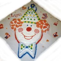 Clown Cake This was made with fluffy white frosting and and buttercream star tip accents. It was sculpted from several different cake pans.